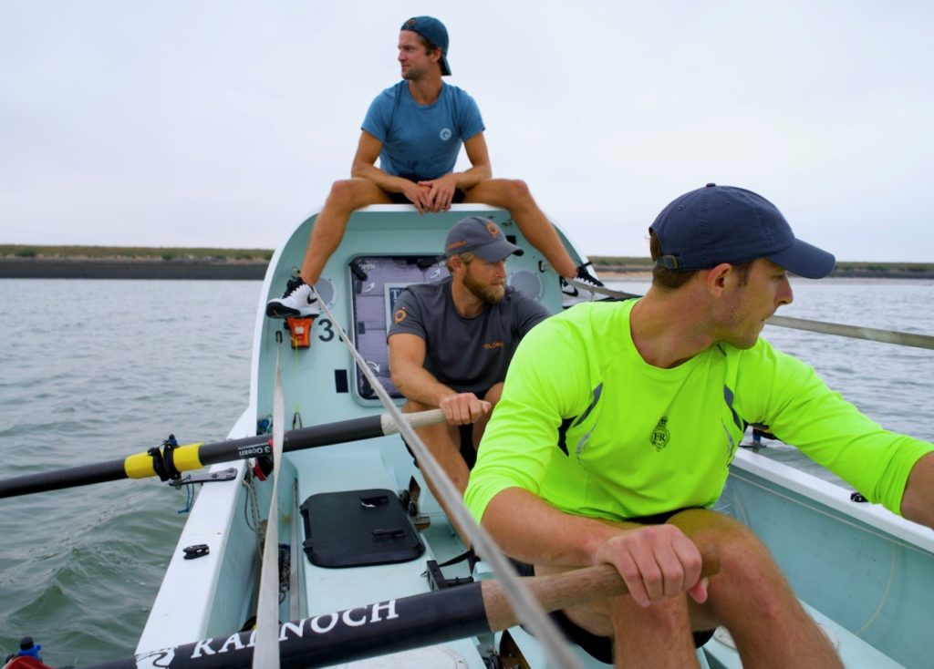 Jimmy and teammates rowing in training