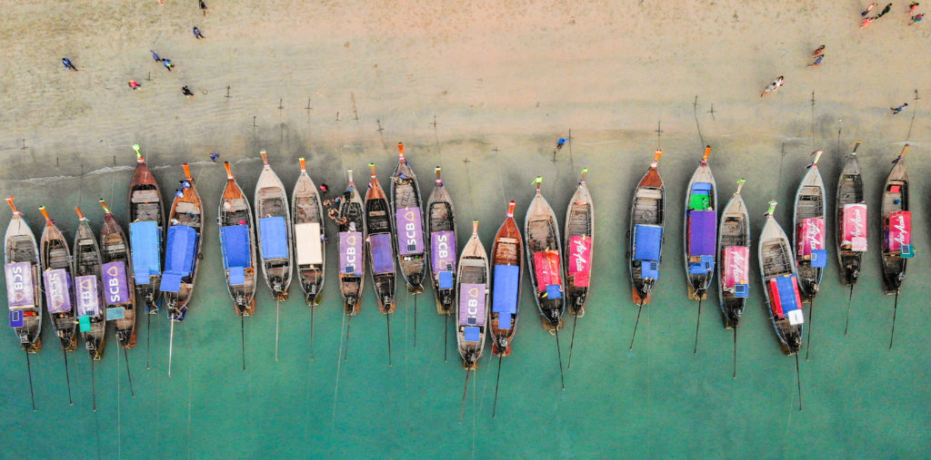 fishermen boats krabi beach thailand