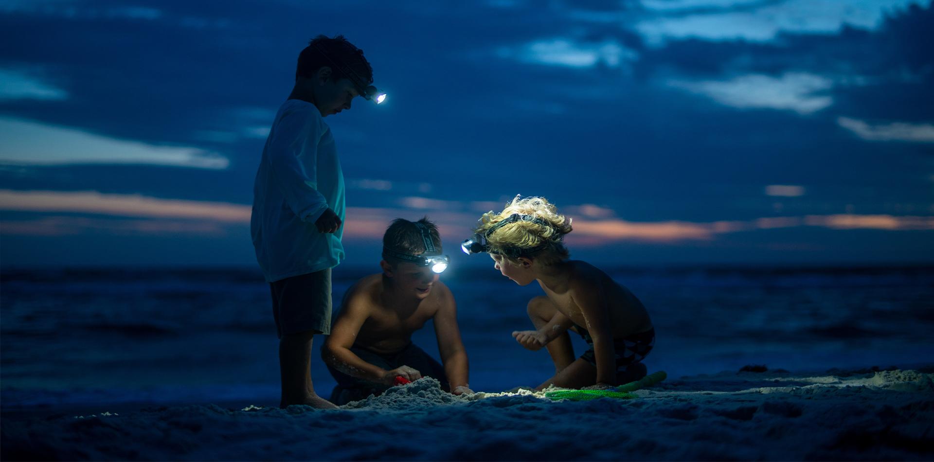 children headtorches beach florida