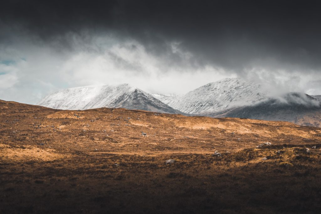 clouds west capped mountains scotland snow highland way